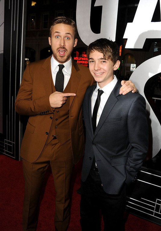 """. Actors Ryan Gosling and Austin Abrams arrive at Warner Bros. Pictures\' \""""Gangster Squad\"""" premiere at Grauman\'s Chinese Theatre on January 7, 2013 in Hollywood, California.  (Photo by Kevin Winter/Getty Images)"""