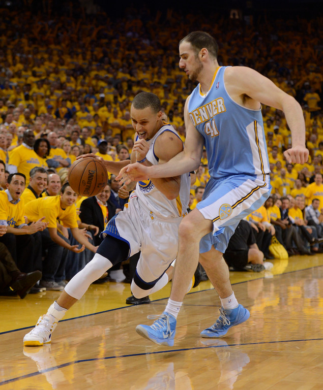 . Stephen Curry (30) of the Golden State Warriors drives on Kosta Koufos (41) of the Denver Nuggets during the thrid quarter in Game 6 of the first round NBA Playoffs May 2, 2013 at Oracle Arena. (Photo By John Leyba/The Denver Post)