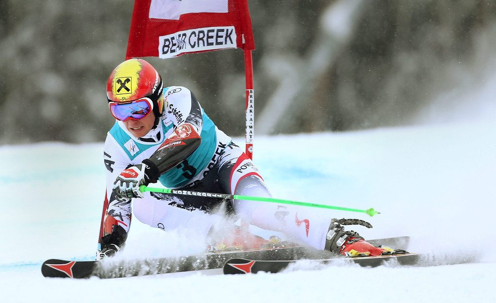 . Marcel Hirscher of Austria on his way to taking third place clears a gate during the men\'s Giant Slalom race at the FIS World Cup Alpine Skiing in Beaver Creek, Colorado, USA, 08 December 2013.  EPA/GEORGE FREY