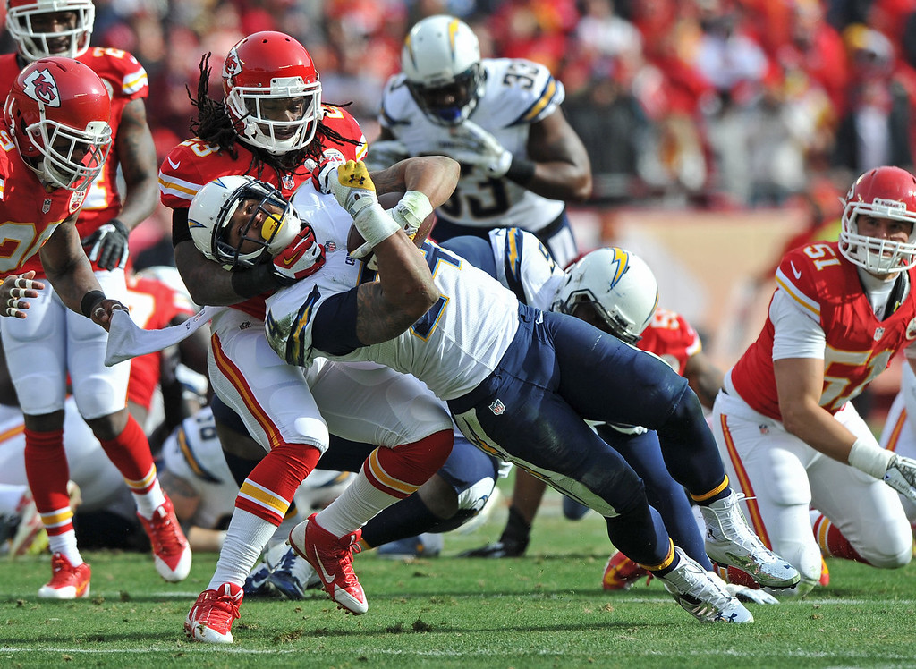 . Safety Kendrick Lewis #23 of the Kansas City Chiefs tackles running back Ryan Mathews #24 of the San Diego Chargers during the first half on November 24, 2013 at Arrowhead Stadium in Kansas City, Missouri.  (Photo by Peter Aiken/Getty Images)