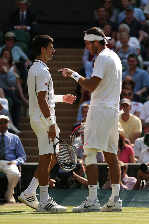 . LONDON, ENGLAND - JULY 05:  Juan Martin Del Potro of Argentina talks with Novak Djokovic of Serbia during the Gentlemen\'s Singles semi-final match on day eleven of the Wimbledon Lawn Tennis Championships at the All England Lawn Tennis and Croquet Club on July 5, 2013 in London, England.  (Photo by Clive Brunskill/Getty Images)