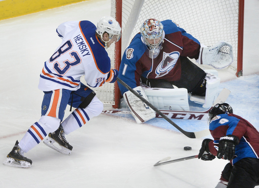 . DENVER, CO. - DECEMBER 19: Edmonton wing Ales Hemsky (83) skated into the crease in front of Avs goaltender Semyon Varlamov in the second period. The Colorado Avalanche hosted the Edmonton Oilers in an NHL game at the Pepsi Center Thursday night, December 19, 2013.  Photo By Karl Gehring/The Denver Post