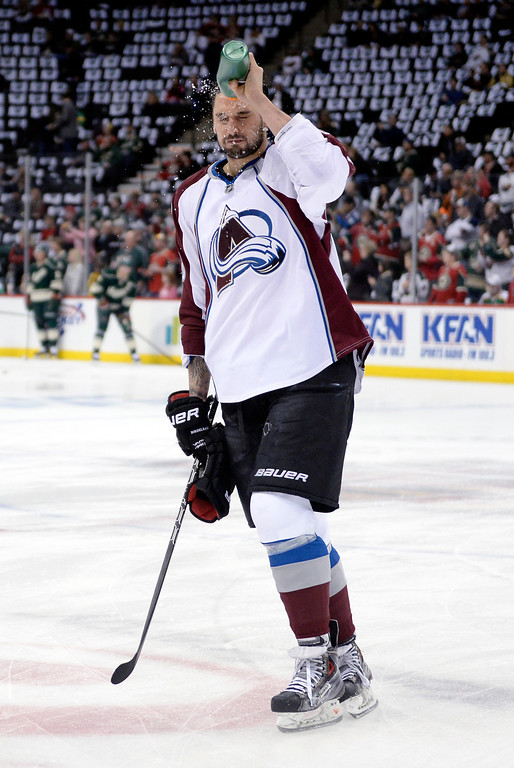 . Avs wing Patrick Bordeleau poured water on his face before the first period as the Minnesota Wild hosted the Colorado Avalanche Thursday night April 24, 2014 at the Xcel Energy Center in St. Paul. (Photo by Karl Gehring/The Denver Post)