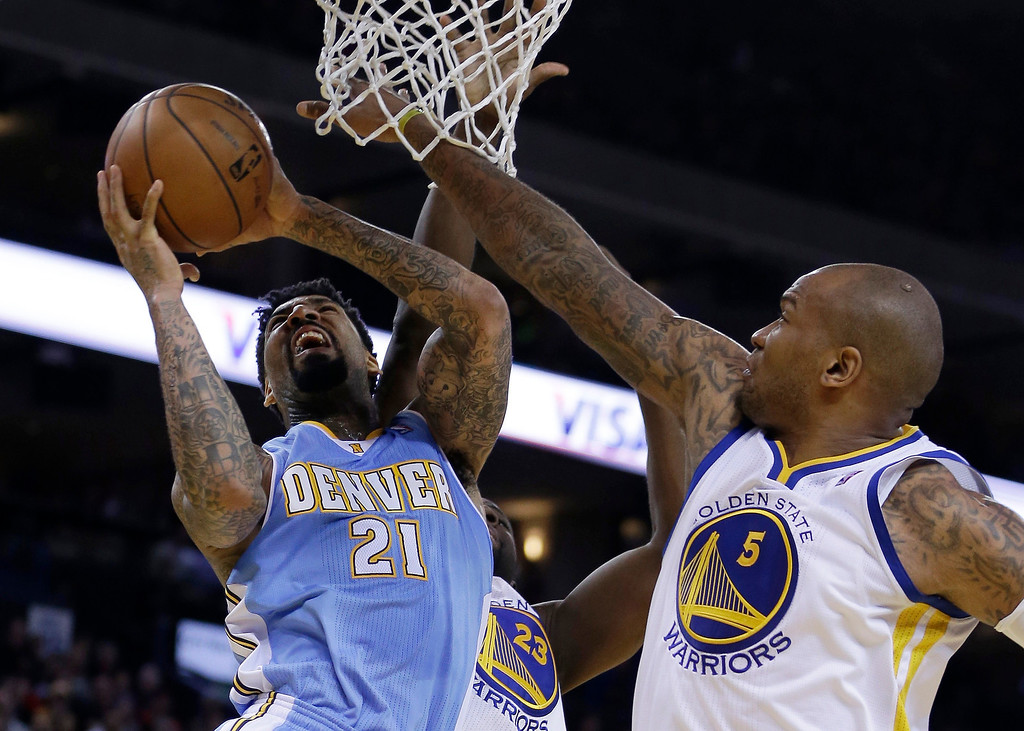 . Denver Nuggets\' Wilson Chandler (21) drives for a shot over Golden State Warriors\' Marreese Speights, right, during the first half of an NBA basketball game Wednesday, Jan. 15, 2014, in Oakland, Calif. (AP Photo/Ben Margot)