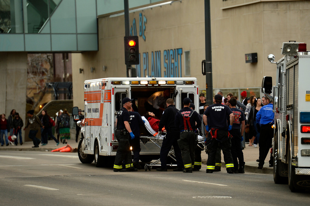. DENVER, CO. - APRIL 20: April 20: A person is loaded into an ambulance by Denver Paramedics, on 13th Street near the scene at Civic Center Park in Denver Colorado, Saturday April 20th, 2013 after the 4/20 pot rally. Two people were shot during Saturday\'s annual 4/20 marijuana rally, held on a day cannabis enthusiasts regard as a holiday called 4/20 that drew tens of thousands to Denver\'s Civic Center park. This is the first 4/20 marijuana rally since Colorado voters legalized marijuana use for people 21 and older in November. April 20, 2013 Denver, Colorado. (Photo By Joe Amon/The Denver Post)