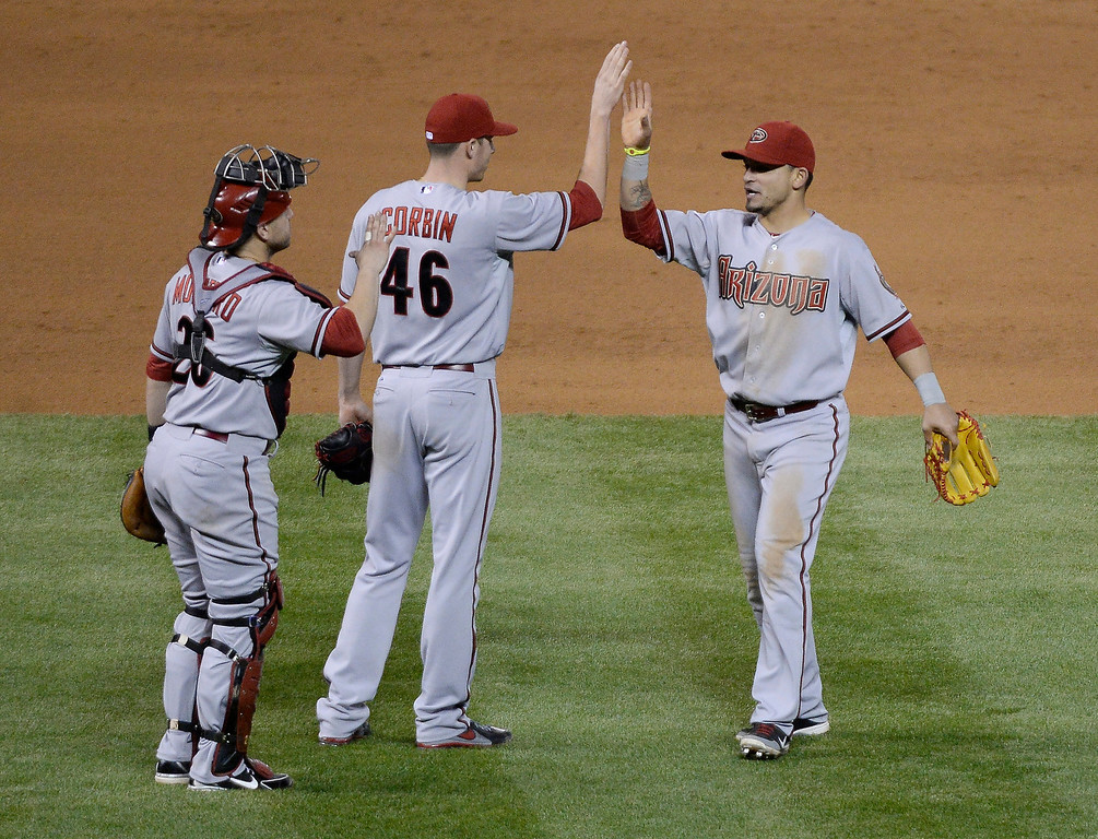 . DENVER, CO. - MAY 20: Miguel Montero (26) Patrick Corbin (46) high five Gerardo Parra (8) of the Arizona Diamondbacks after their win over the Colorado Rockies 5-1 May 20, 2013 at Coors Field. (Photo By John Leyba/The Denver Post)