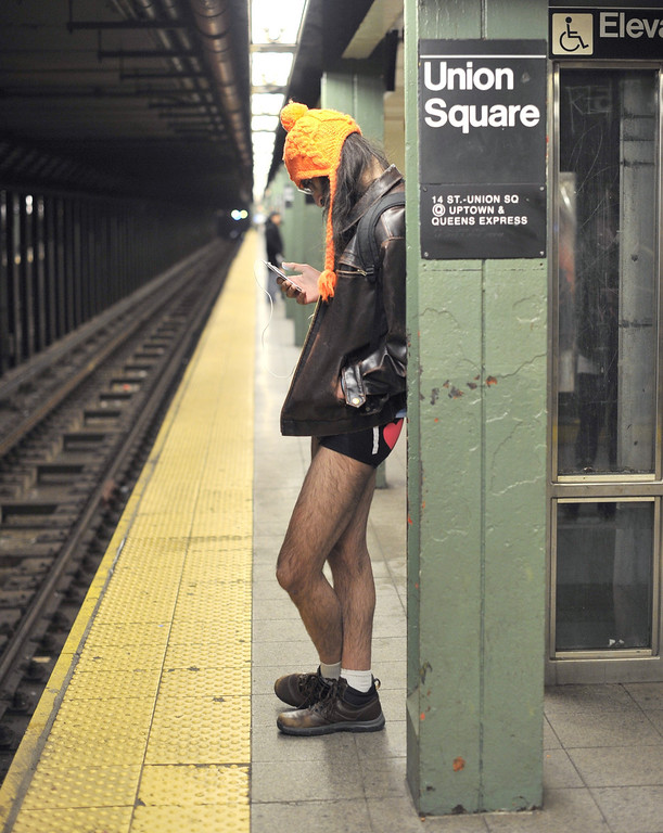 . A rider waits for a train in the New York subway in his underwear as he takes part in the 2014 No Pants Subway Ride on January 12, 2014. Started by Improv Everywhere, the goal is for riders to get on the subway train dressed in normal winter clothes without pants and keep a straight face.   TIMOTHY A. CLARY/AFP/Getty Images