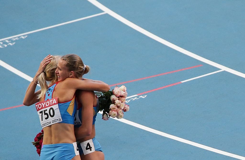 . Russia\'s Kseniya Ryzhova (L) and Russia\'s Tatyana Firova celebrate after winning the women\'s 4x400 metres relay final at the 2013 IAAF World Championships at the Luzhniki stadium in Moscow on August 17, 2013.     LOIC VENANCE/AFP/Getty Images