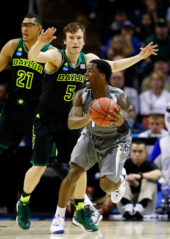. Austin Chatman #1 of the Creighton Bluejays looks to pass as Brady Heslip #5 of the Baylor Bears defends during the third round of the 2014 NCAA Men\'s Basketball Tournament at the AT&T Center on March 23, 2014 in San Antonio, Texas.  (Photo by Tom Pennington/Getty Images)
