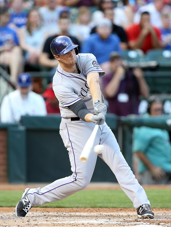 . Vinny Castilla #9 of the Colorado Rockies hits a single in the second inning against the Texas Rangers at Globe Life Park in Arlington on May 7, 2014 in Arlington, Texas.  (Photo by Rick Yeatts/Getty Images)
