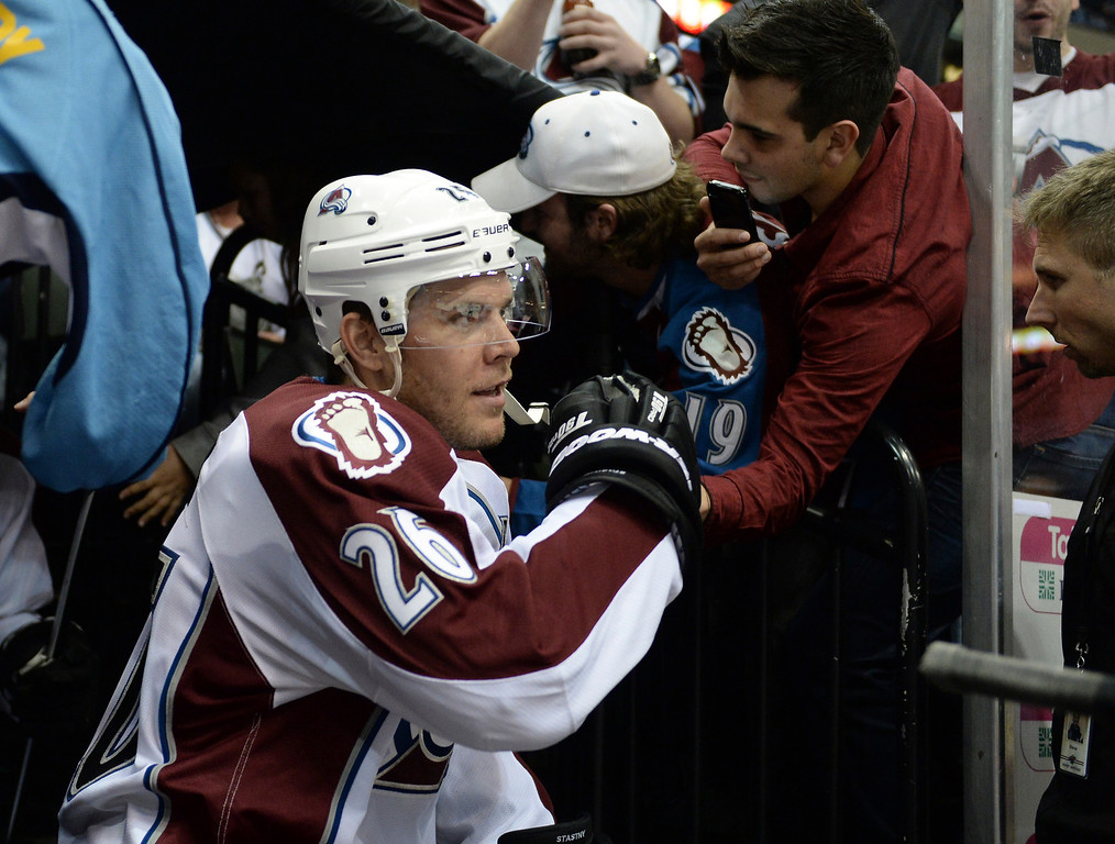. Avs center Paul Stastny bumped fists with fans before the game.  (Photo by Karl Gehring/The Denver Post)