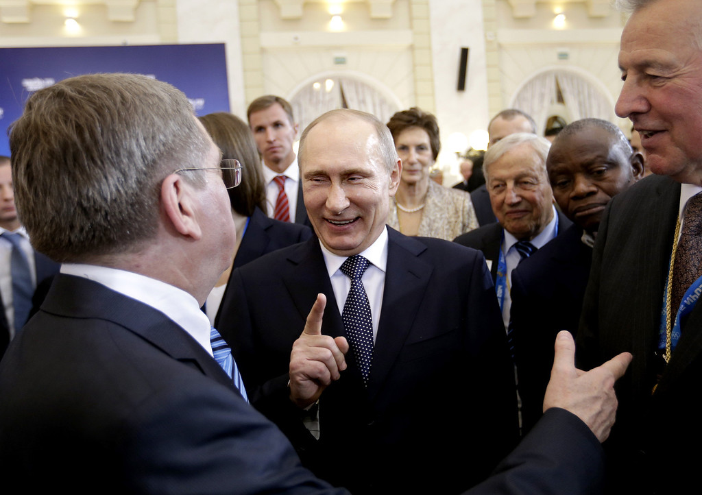. Russian President Vladimir Putin (C) talks with International Olympic Committee President Thomas Bach at a welcoming event for IOC members ahead of the 2014 Winter Olympics at the Rus Hotel February 4, 2014, in Sochi, Russia. (Photo by David Goldman-Pool/Getty Images)