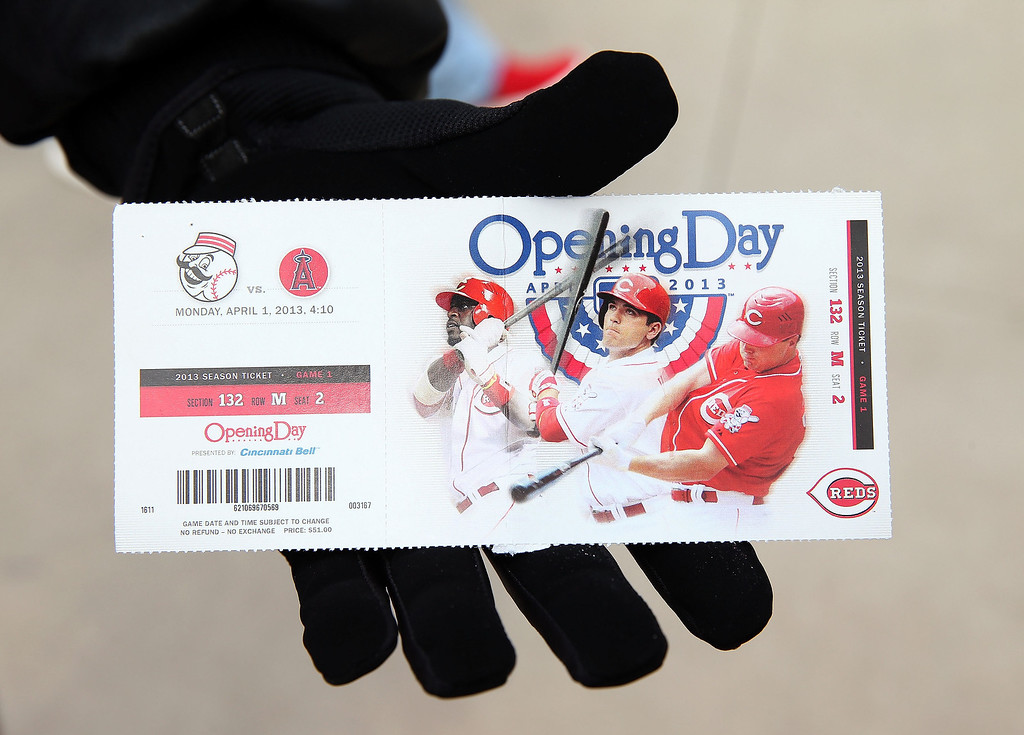 . A fan holds a opening day ticket before the start of the Los Angeles Angels of Anaheim game against the Cincinnati Reds at Great American Ball Park on April 1, 2013 in Cincinnati, Ohio.  (Photo by Andy Lyons/Getty Images)