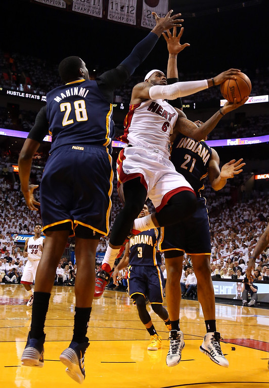 . LeBron James #6 of the Miami Heat goes to the basket against David West #21 and Ian Mahinmi #28 of the Indiana Pacers during Game Four of the Eastern Conference Finals of the 2014 NBA Playoffs at American Airlines Arena on May 26, 2014 in Miami, Florida.  (Photo by Mike Ehrmann/Getty Images)