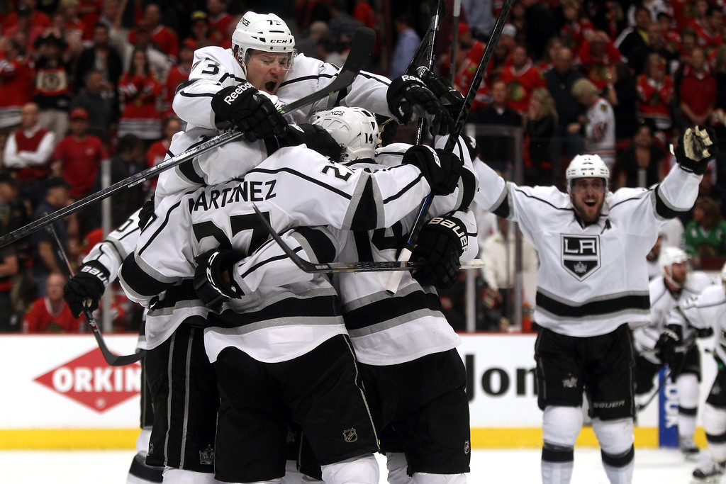 . The Los Angeles Kings celebrate defeating the Chicago Blackhawks 5 to 4 in overtime in Game Seven to win the Western Conference Final in the 2014 Stanley Cup Playoffs at United Center on June 1, 2014 in Chicago, Illinois.  (Photo by Justin Heiman/Getty Images)