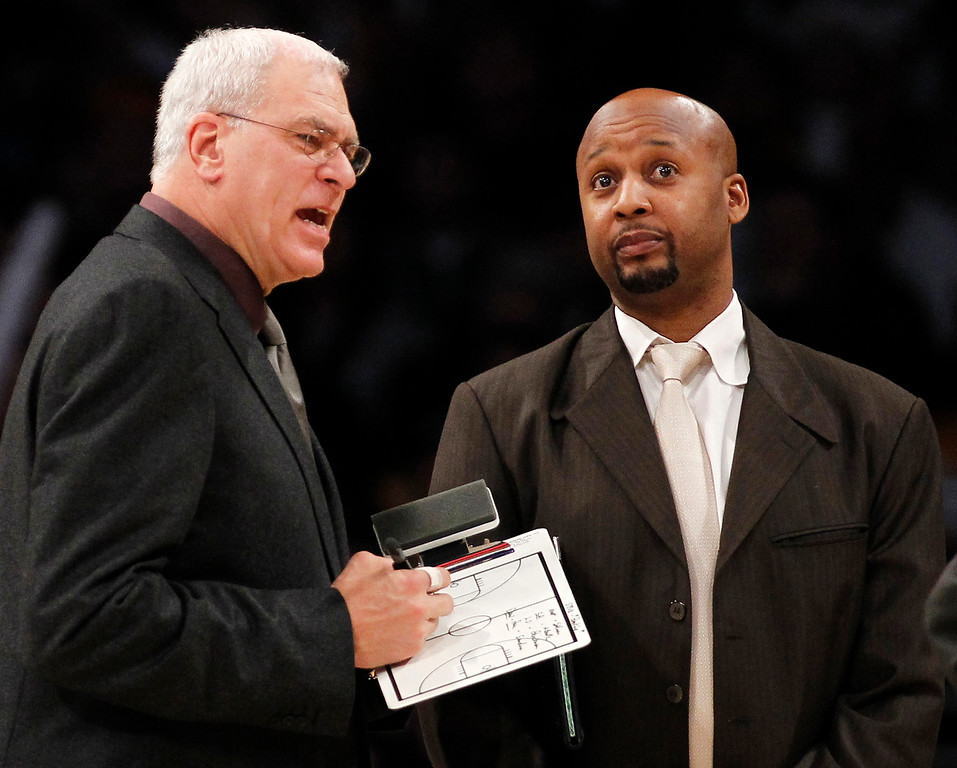 . Los Angeles Lakers assistant coach Brian Shaw stands with head coach Phil Jackson during a timeout against the Milwaukee Bucks during an NBA basketball game in Los Angeles in 2010. Shaw, who later became an assistant with the Indiana Pacers, was named head coach of the Denver Nuggets on June 24, 2013.    (AP Photo/Danny Moloshok, File)