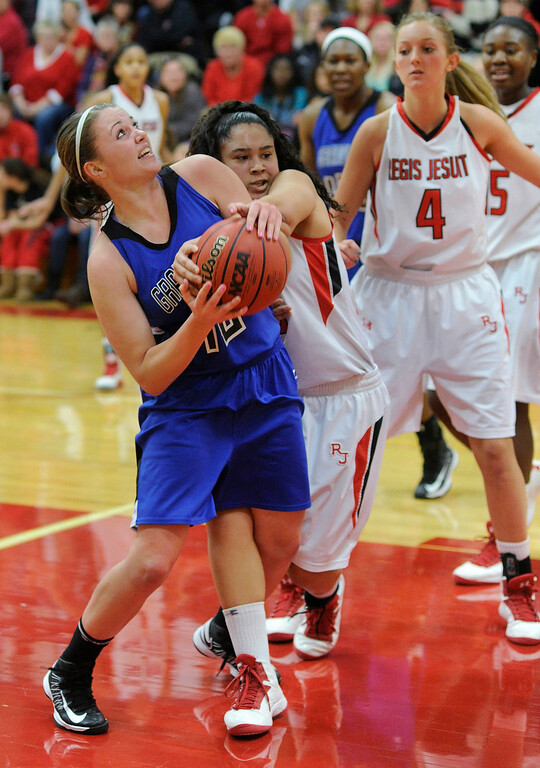 . Regis defender Kelsi Lidge (25) tied up Grandview\'s Erin Kemp (12) in the second quarter. The Regis Jesuit High School girl\'s  basketball team hosted Grandview Saturday night, January 12, 2013. Karl Gehring/The Denver Post