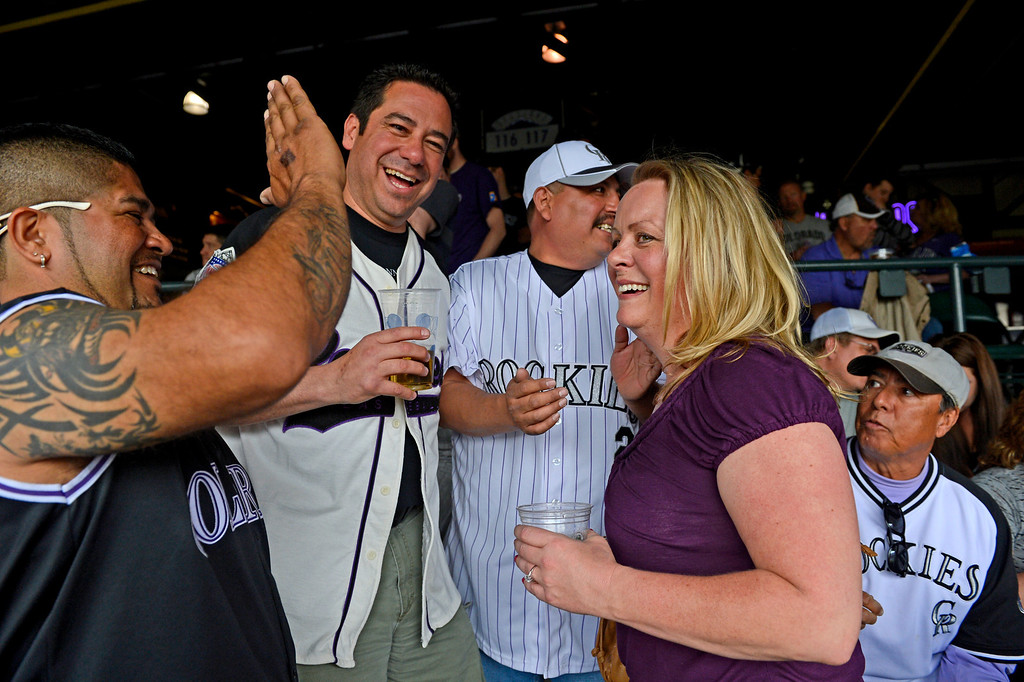 . Rockies fans congratulate Keri Farmer and Jerry Baca, second from left, after Baca proposed to Farmer during the game.  (Photo by Andy Cross/The Denver Post)