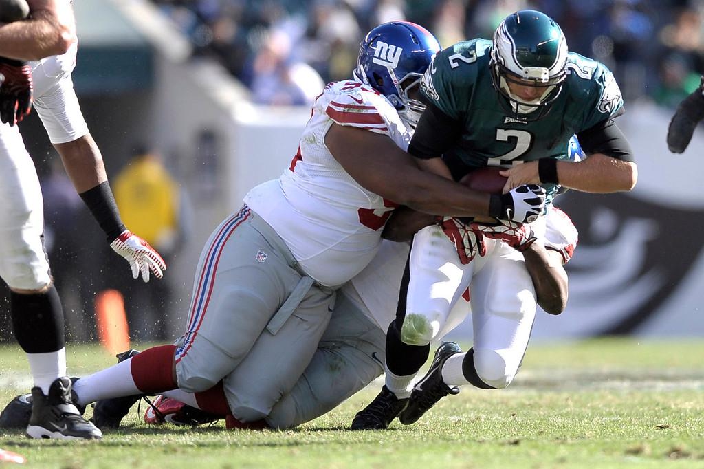 . New York Giants defensive tackle Mike Patterson, left, and Mathias Kiwanuka, sack Philadelphia Eagles\' Matt Barkley (2) during the second half of an NFL football game Sunday, Oct. 27, 2013, in Philadelphia. (AP Photo/Michael Perez)
