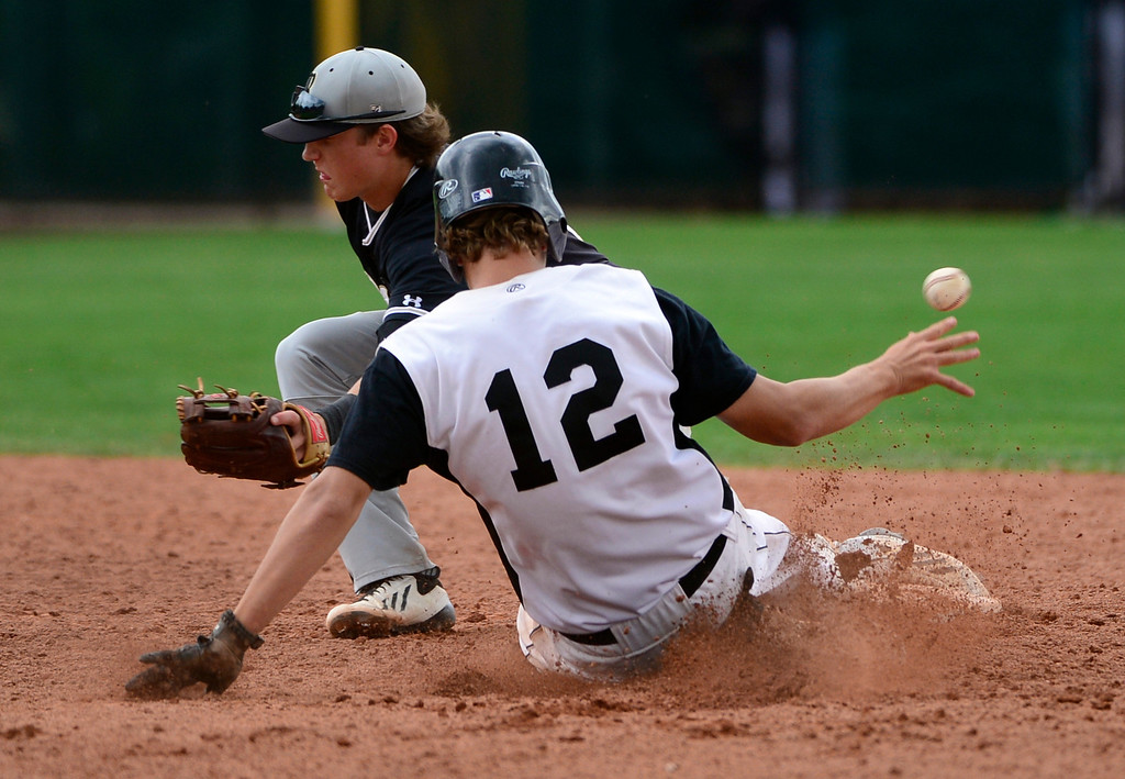 . LAKEWOOD, CO - MAY 23: Durango\'s Wyatt Wymore is safe at second base as the ball gets past Green Mountain\'s Reid Effrein. The Durango Demons take on the Green Mountain Rams in the 4A Baseball State Semi-Final Championships. (Kathryn Scott Osler, The Denver Post)