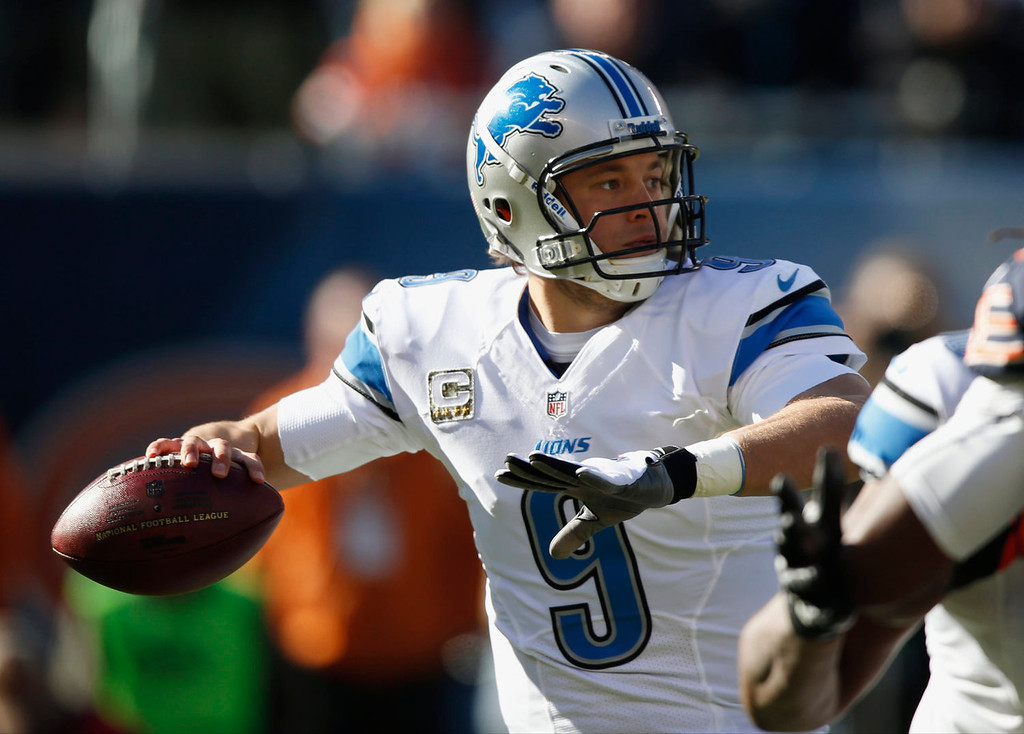 . Detroit Lions quarterback Matthew Stafford (9) throws a pass during the first half of an NFL football game against the Chicago Bears, Sunday, Nov. 10, 2013, in Chicago. (AP Photo/Charles Rex Arbogast)