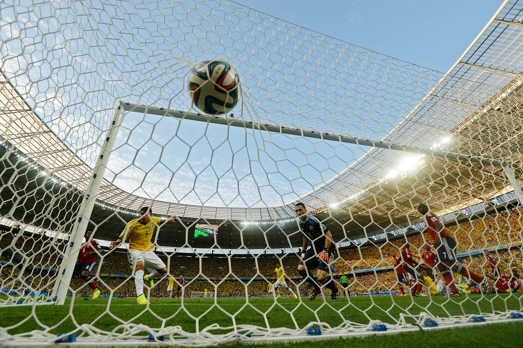 . Brazil\'s defender and captain Thiago Silva (2ndL) scores during the quarter-final football match between Brazil and Colombia at the Castelao Stadium in Fortaleza during the 2014 FIFA World Cup on July 4, 2014. EITAN ABRAMOVICH/AFP/Getty Images