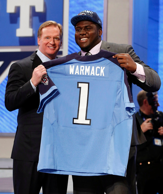 . Chance Warmack (R) from the University of Alabama stands with NFL Commissioner Roger Goodell after being selected by the Tennessee Titans as the 10th overall pick in the 2013 National Football League (NFL) Draft at Radio City Music Hall in New York, April 25, 2013. REUTERS/Shannon Stapleton