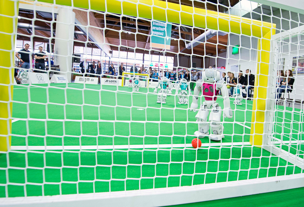 . A robot scores during a soccer match at the RoboCup GermanOpen 2014 in Magdeburg, Germany, Thursday, April 3, 2014. 44 international RoboCup Major League teams from 12 countries demonstrate the state-of-the-art competitions in soccer, rescue and service robots. The RoboCup German Open takes place from April 3 to April 5, 2014. (AP Photo/Jens Meyer)