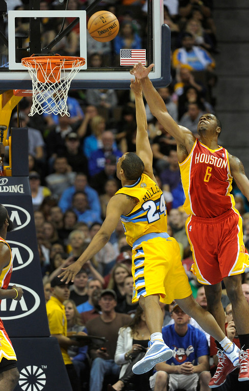 . DENVER, CO. - APRIL 6: Terrence Jones (6) of the Houston Rockets went for a block on a shot by Andre Miller (24) of the Denver Nuggets in the first half. The Denver Nuggets hosted the Houston Rockets at the Pepsi Center Saturday night, April 6, 2013. Photo By Karl Gehring/The Denver Post)