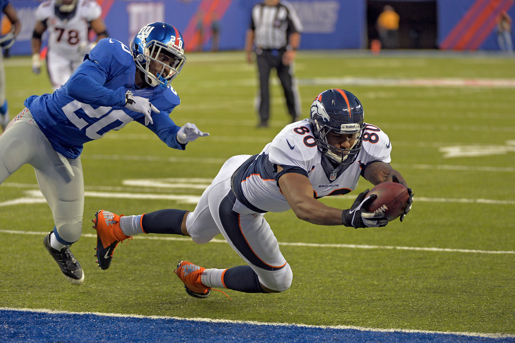 . EAST RUTHERFORD , NJ -SEPTEMBER 15: New York Giants cornerback Prince Amukamara (20) can\'t make the tackle as Denver Broncos tight end Julius Thomas (80) dives over the goal line for a touchdown during the fourth quarter September 15, 2013 MetLife Stadium. (Photo by John Leyba/The Denver Post)