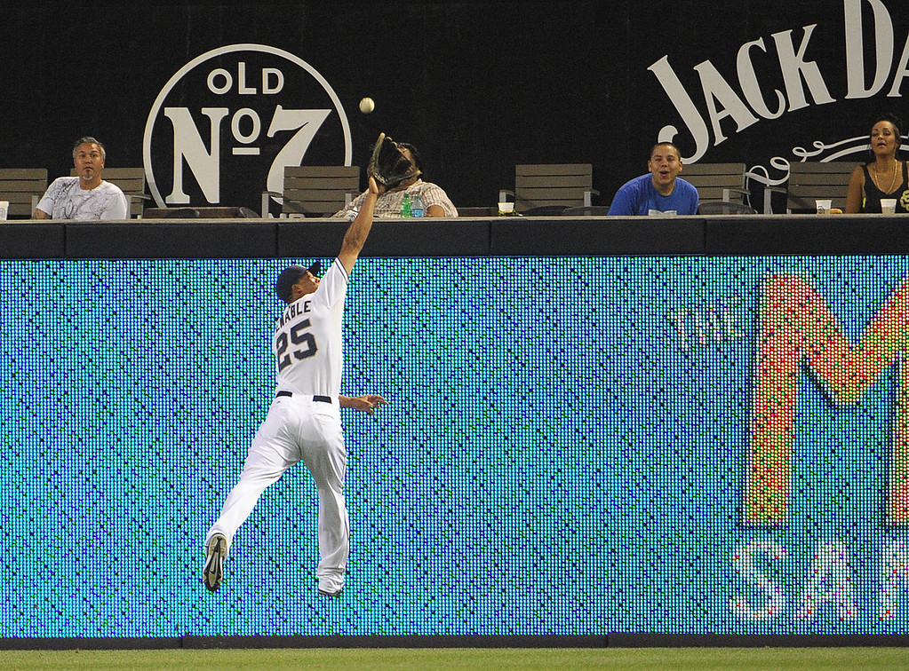 . SAN DIEGO, CA - SEPTEMBER 6:  Will Venable #25 of the San Diego Padres can\'t make the catch on a double hit by Troy Tulowitzki #2 of the Colorado Rockies during the first inning of a baseball game at Petco Park on September 6, 2013 in San Diego, California.  (Photo by Denis Poroy/Getty Images)