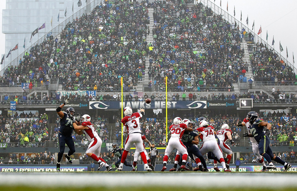 . Carson Palmer #3 of the Arizona Cardinals throws a pass against the Seattle Seahawks on December 22, 2013 at CenturyLink Field in Seattle, Washington.  (Photo by Jonathan Ferrey/Getty Images)