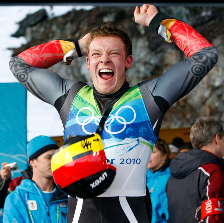 . Felix Loch of Germany celebrates his gold medal finish during the final run of the men\'s singles luge competition at the Vancouver 2010 Olympics in Whistler, British Columbia, Sunday, Feb. 14, 2010. (AP Photo/Michael Sohn)