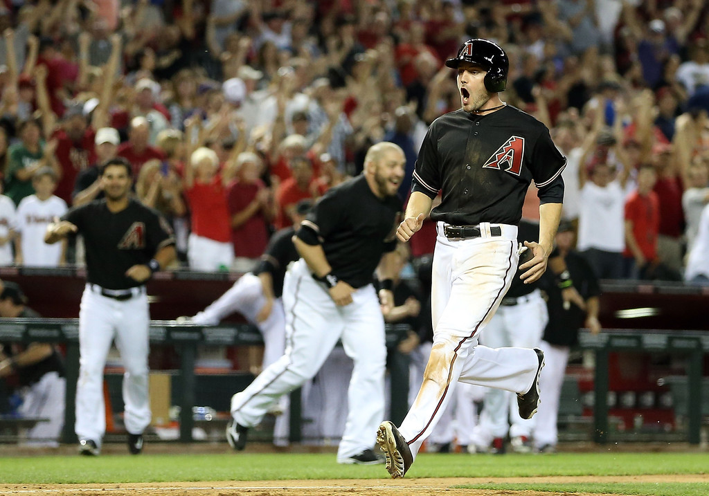. A.J. Pollock #11 of the Arizona Diamondbacks reacts as he scores the winning run on a walk off sacrifice fly hit by Cody Ross (not pictured) in the 10th inning of the MLB game against the Colorado Rockies at Chase Field on April 27, 2013 in Phoenix, Arizona.  (Photo by Christian Petersen/Getty Images)