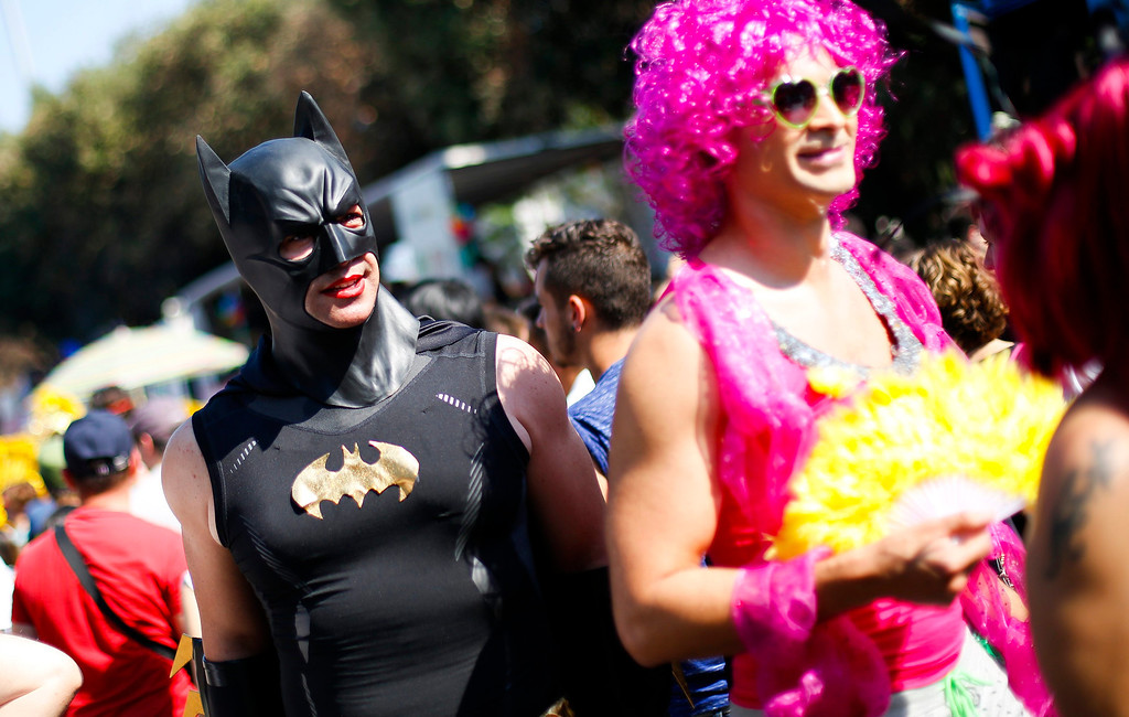 . A man dressed as Batman performs during the annual gay pride parade in downtown Rome June 15, 2013. REUTERS/Max Rossi
