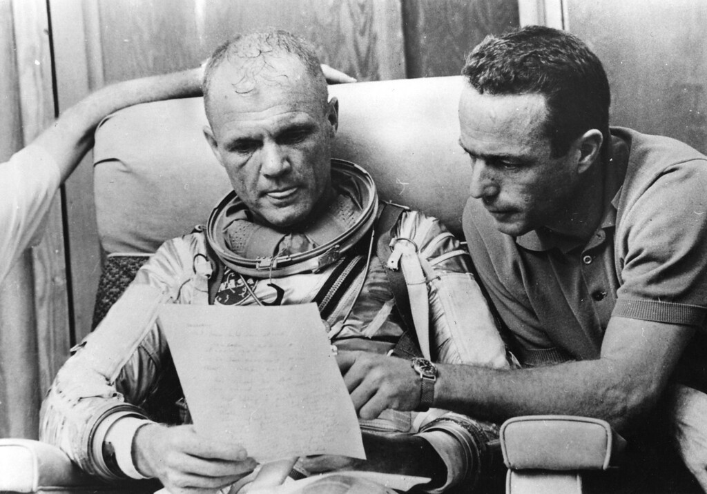 . American astronaut Lt Col John Glenn checks over notes with back-up pilot Scott Carpenter after a simulated flight, prior to the Mercury-Atlas 6 mission at Cape Canaveral, the object of which is to put the first American spaceman into orbit around the Earth.    (Photo by Keystone/Getty Images)
