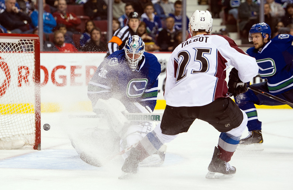 . Max Talbot #25 of the Colorado Avalanche watches teammate Tyson Barrie\'s (not picutred) shot go past goalie Jacob Markstrom #35 of the Vancouver Canucks for a goal during the third period in NHL action on April 10, 2014 at Rogers Arena in Vancouver, British Columbia, Canada.  (Photo by Rich Lam/Getty Images)
