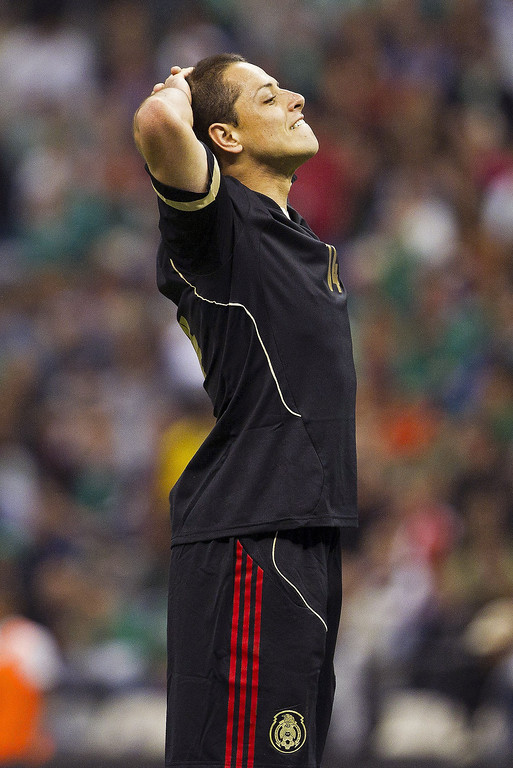 . Mexico\'s Javier Hernandez reacts after missing a chance to score against the United States during a 2014 World Cup qualifying match at the Aztec stadium in Mexico City, Tuesday, March 26, 2013. (AP Photo/Christian Palma)