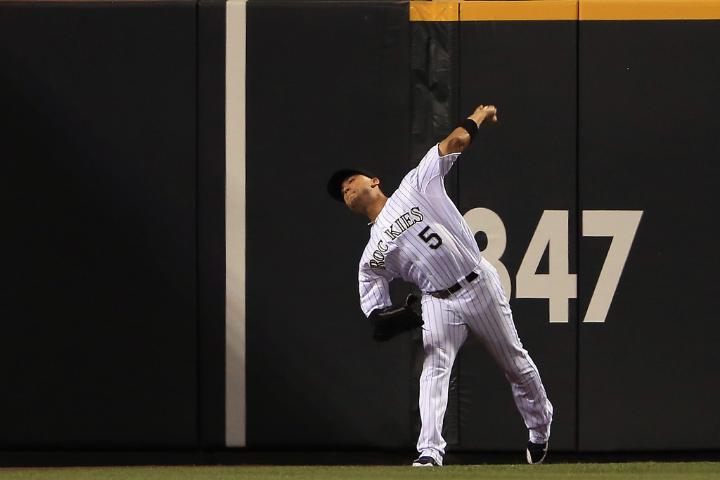 . Leftfielder Carlos Gonzalez #5 of the Colorado Rockies fields a double by Tim Federowicz #18 of the Los Angeles Dodgers and makes the throw to the infield in the eighth inning at Coors Field on September 3, 2013 in Denver, Colorado.  (Photo by Doug Pensinger/Getty Images)
