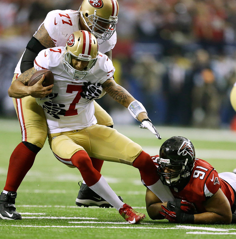 . Atlanta Falcons\' Corey Peters (91) sacks San Francisco 49ers\' Colin Kaepernick (7) during the first half of the NFL football NFC Championship game Sunday, Jan. 20, 2013, in Atlanta. Trying to hold up Kaepernick is 49ers\' Mike Iupati. (AP Photo/David Goldman)