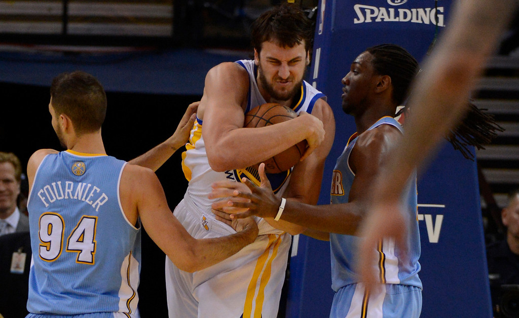 . OAKLAND, CA. - APRIL 26: Andrew Bogut (12) of the Golden State Warriors fights off Evan Fournier (94) of the Denver Nuggets and Kenneth Faried (35) for the ball in game 3 of the first round of the NBA Playoffs April 26, 2013 at Oracle Arena.  (Photo By John Leyba/The Denver Post)