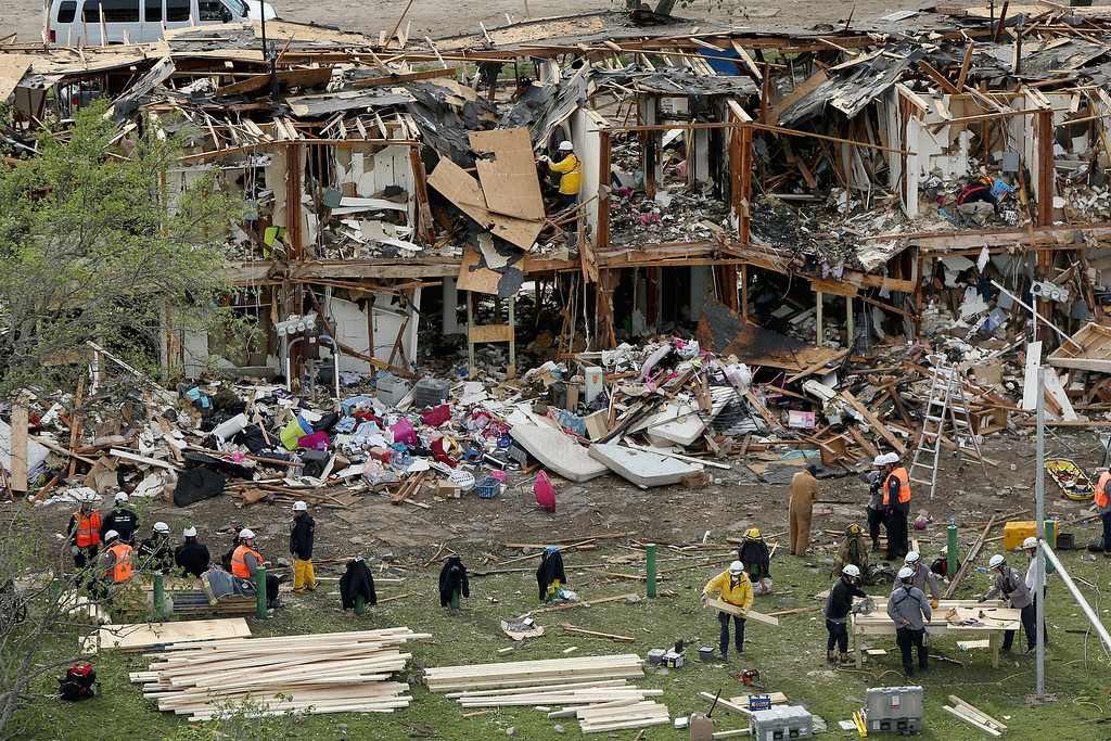 . WEST, TX - APRIL 18:  Search and rescue workers comb through what remains of a 50-unit apartment building the day after an explosion at the West Fertilizer Company destroyed the building April 18, 2013 in West, Texas. According to West Mayor Tommy Muska, around 35 people, including 10 first responders, were killed and more than 150 people were injured when the fertilizer company caught fire and exploded, leaving damaged buildings for blocks in every direction.  (Photo by Chip Somodevilla/Getty Images)