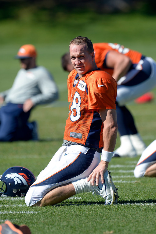 . Denver Broncos quarterback Peyton Manning (18)stretches before practice October 2, 2013 at Dove Valley. (Photo by John Leyba/The Denver Post)