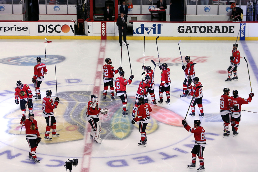 . The Chicago Blackhawks celebrate after defeating the Los Angeles Kings in double overtime of Game Five of the Western Conference Final in the 2014 Stanley Cup Playoffs at United Center on May 28, 2014 in Chicago, Illinois.  The Chicago Blackhawks defeated the Los Angeles Kings 5 to 4.  (Photo by Tasos Katopodis/Getty Images)