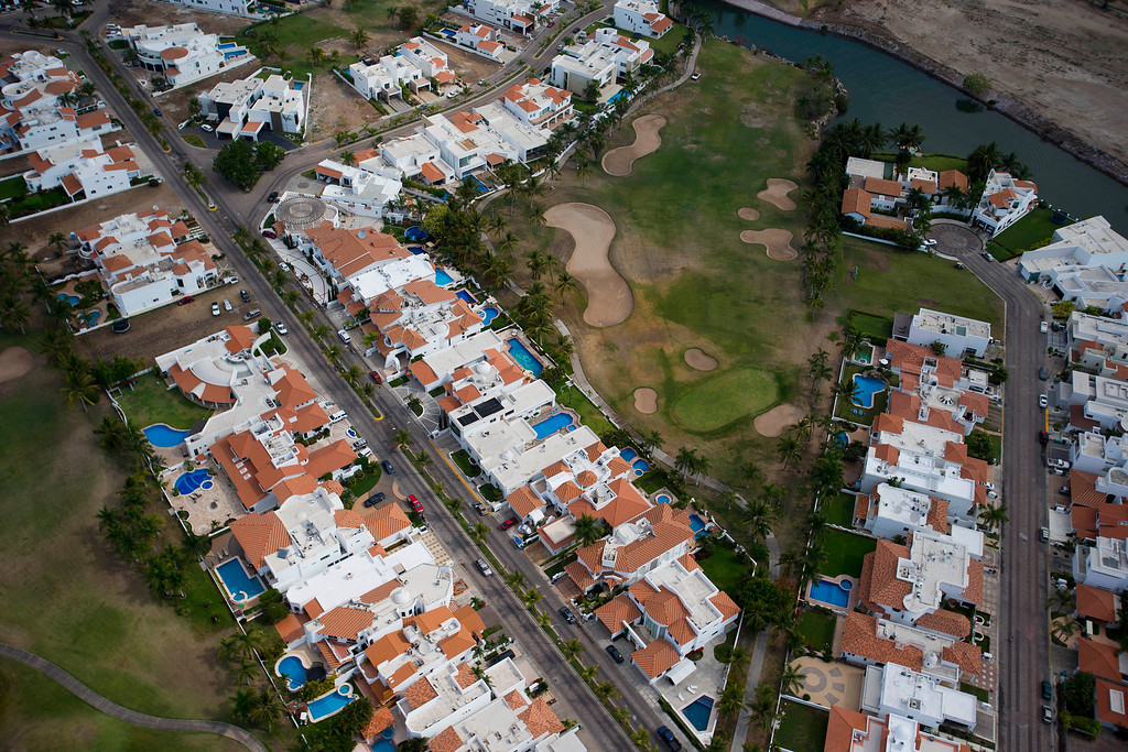 . This June 11, 2013 photo, shows an aerial view of vacation homes and a golf course in the Pacific resort city of Mazatlan, Mexico. Sinaloa state tourism officials predict an ìexplosionî for the resort city of Mazatlan, hard hit by drug violence in recent years, as a new Durango-Mazatlan Highway gives Mexicans in interior states an easy drive to the beach. (AP Photo/Dario Lopez-Mills)