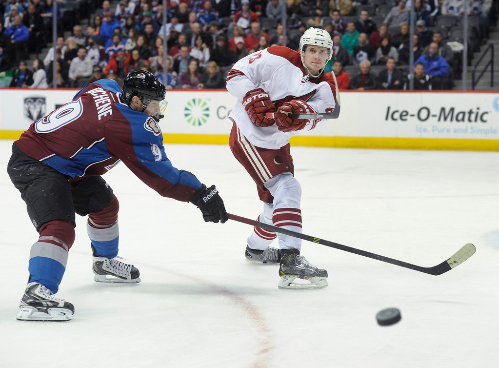 . Phoenix defenseman Oliver Ekman-Larsson (23) cleared the puck away from Colorado center Matt Duchene (9) in the third period.    Photo By Karl Gehring/The Denver Post