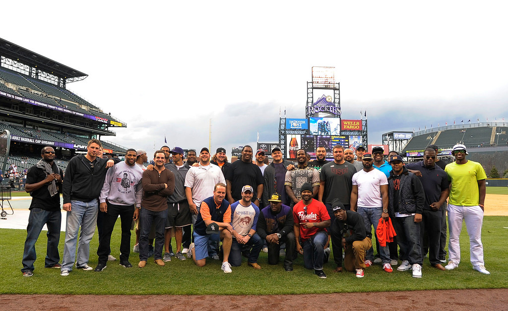 . DENVER, CO. - MAY 07: Some of the Denver Broncos team pose for a photo during the Colorado Rockies New York Yankees batting practice May 7, 2013 at Coors Field. (Photo By John Leyba/The Denver Post)