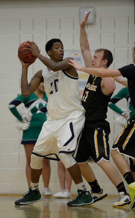 . AURORA, CO - FEBRUARY 12: Overland De\'Ron Davis (20) looks to pass as he get guarded by Arapahoe Ethan Brunhofer (11) during their 5A basketball game February 12, 2014 in Aurora. (Photo by John Leyba/The Denver Post)
