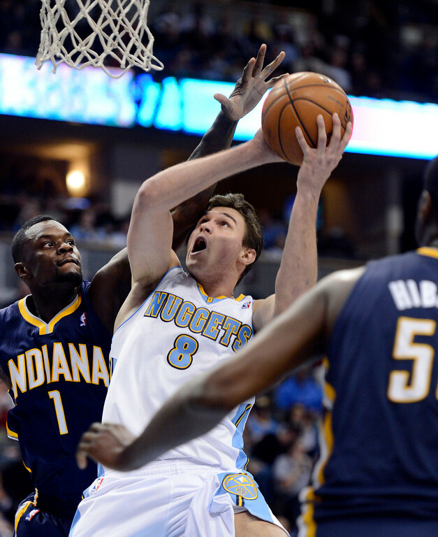 . DENVER, CO. - JANUARY 28: Denver Nuggets small forward Danilo Gallinari (8) gets fouled by Indiana Pacers shooting guard Lance Stephenson (1) during the third quarter January 28, 2013 at Pepsi Center. The Denver Nuggets defeated  the Indiana Pacers 102-101 in NBA Action. (Photo By John Leyba / The Denver Post)