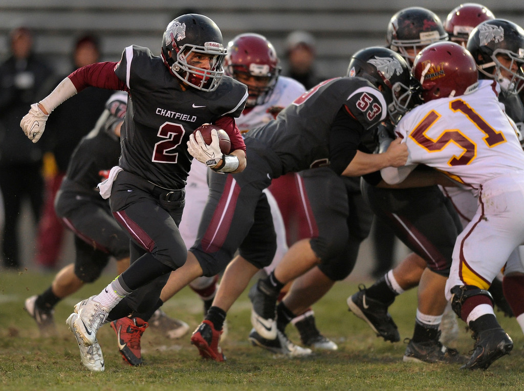 . Chatfield receiver Sean O\'Dell (2) broke around the edge in the first quarter.  Photo By Karl Gehring/The Denver Post